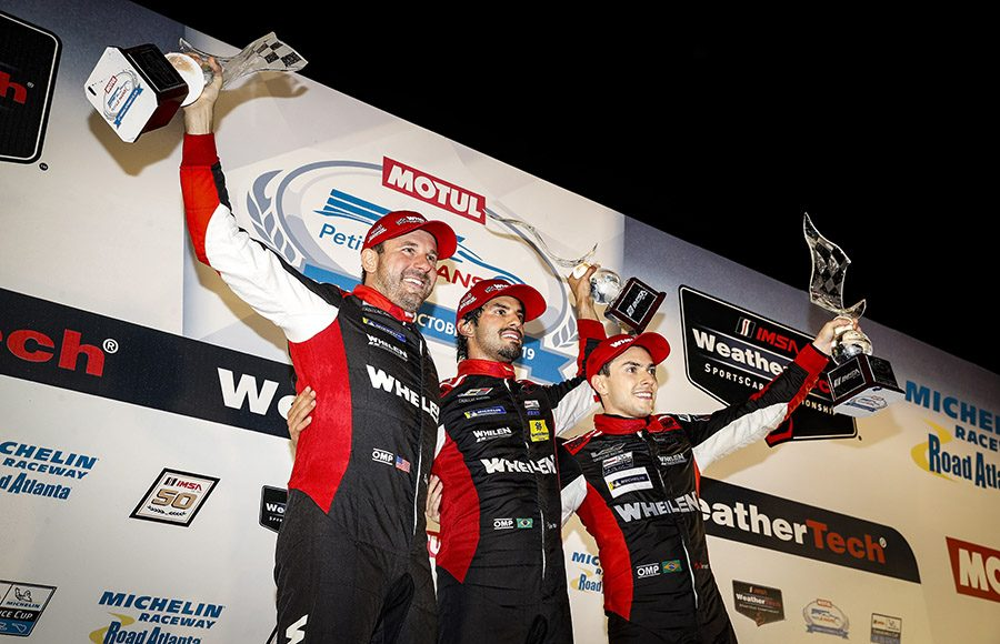 Felipe Nasr, Pipo Derani and Eric Curran celebrate after winning the Petit Le Mans on Sunday. (IMSA Photo)