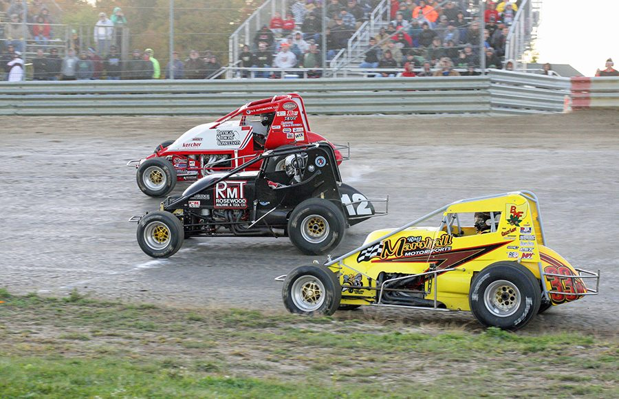 Buckeye Outlaw Sprint Series competitors battle for position during a heat race on Saturday at Waynesfield Raceway Park. (Todd Ridgeway Photo)