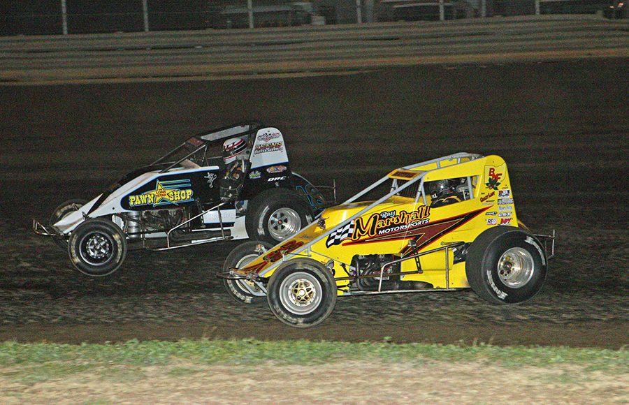 Matt Westfall (33m) and Dallas Hewitt battle during the Buckeye Outlaw Sprint Series portion of the Bob Hampshire Classic Saturday at Waynesfield Raceway Park. (Todd Ridgeway Photo)