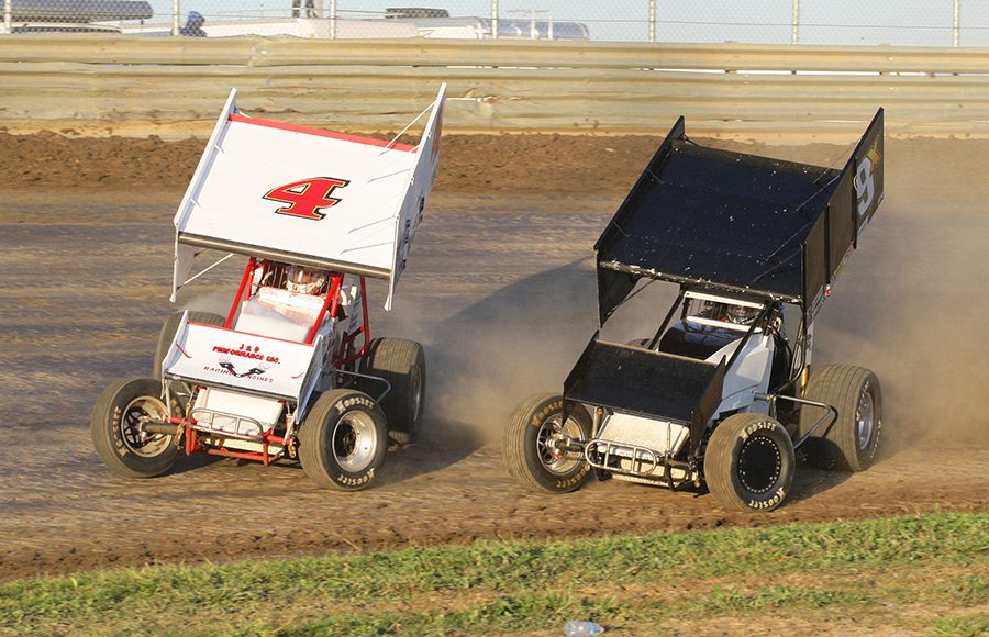 Danny Smith (4) races alongside Ricky Peterson during Saturday's FAST Series Bob Hampshire Classic event at Waynesfield Raceway Park. (Todd Ridgeway Photo)