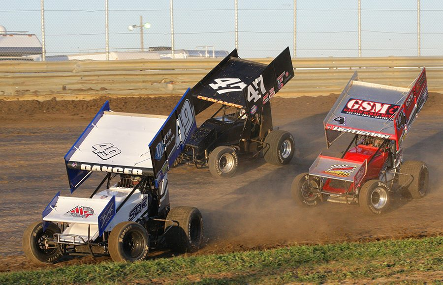 Shawn Dancer (49), Chad Kemenah (K4), and Caleb Helms race for position during Saturday's FAST Series Bob Hampshire Classic event at Waynesfield Raceway Park. (Todd Ridgeway Photo)