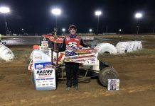 Jesse Colwell in victory lane Saturday night at I-30 Speedway. (POWRi Photo)