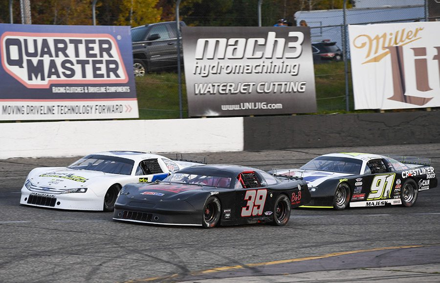 Andrew Morrissey (29), Johnny Sauter (5) and Ty Majeski race for position during the Falloween 150 Saturday at Dells Raceway Park. (Doug Hornickel Photo)