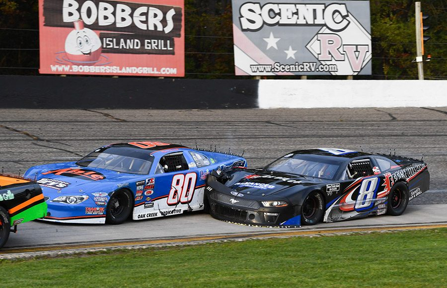 Ryan Farrell (80) and Eddie Hoffman make contact while racing for position during the Falloween 150 Saturday at Dells Raceway Park. (Doug Hornickel Photo)