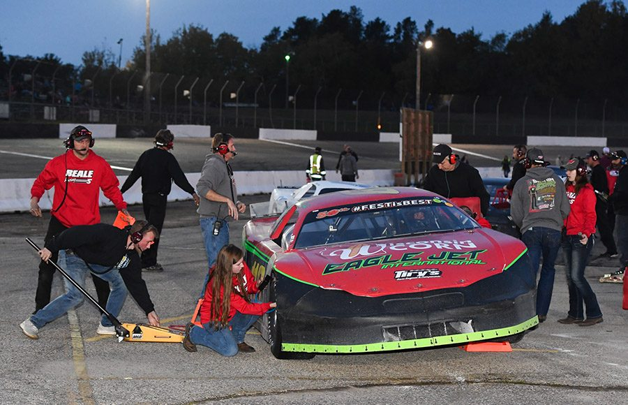 Dalton Zehr's crew makes changes to his car during a pit stop as part of Saturday's Falloween 150 Saturday at Dells Raceway Park. (Doug Hornickel Photo)