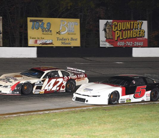 Travis Sauter (5) races to the inside of Dennis Prunty during the Falloween 150 Saturday at Dells Raceway Park. (Doug Hornickel Photo)