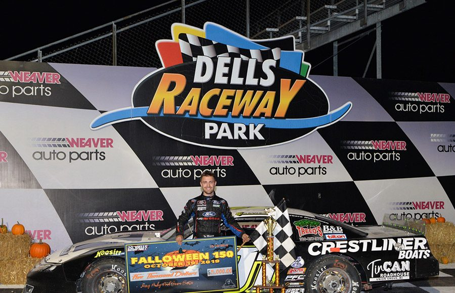 Ty Majeski poses in victory lane after winning Saturday's Falloween 150 at Dells Raceway Park. (Doug Hornickel Photo)