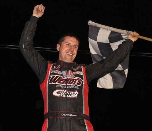 Mat Williamson celebrates after winning the $15,000 small-block modified feature Saturday at Orange County Fair Speedway. (Dan Demarco Photo)