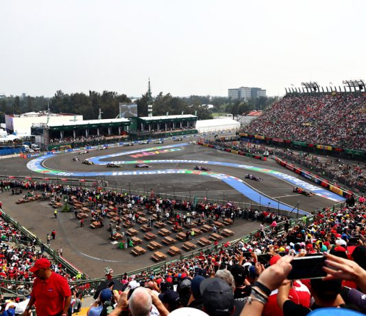 The field flows through the stadium portion of the track during Sunday's Mexican Grand Prix. (Red Bull Photo)