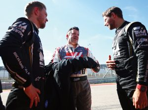 Tony Stewart (center) talks with Haas F1 Team drivers Kevin Magnussen (left) and Romain Grosjean (right) Thursday at Circuit of the Americas. (Dan Istitene/Getty Images Photo)