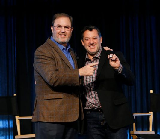 Texas Motor Speedway President/GM Eddie Gossage (left) poses with Texas Motorsports Hall of Fame inductee Tony Stewart. (Getty Images Photo)