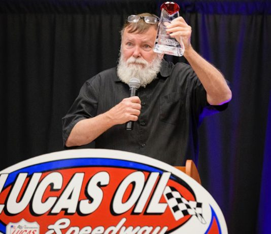 Long-time announcer Kevin Fletcher received the 2019 Forrest Lucas Lifetime Achievement Award at Saturday night's Lucas Oil Speedway Awards Banquet. (Kenny Shaw photo)