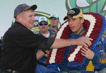 Richard Brickhouse (left) puts a wreath over the head of 2009 Talladega Speedway race winner Jamie McMurray. (NASCAR Photo)