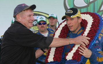Richard Brickhouse (left) puts a wreath over the head of 2009 Talladega Speedway race winner Jamie McMurray. (NASCAR Photo)