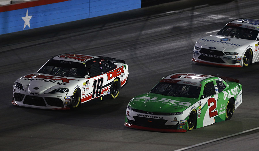 Harrison Burton (18) races around the outside of Tyler Reddick during Saturday's NASCAR Xfinity Series race at Texas Motor Speedway. (HHP/Ashley Dickerson Photo)