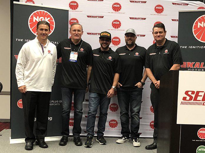 NGK Vice President of Aftermarket Brian Norko, Doug Kalitta, J.R. Todd, Shawn Langdon and Chad Head at NGK Kalitta Motorsports sponsorship announcement during SEMA.