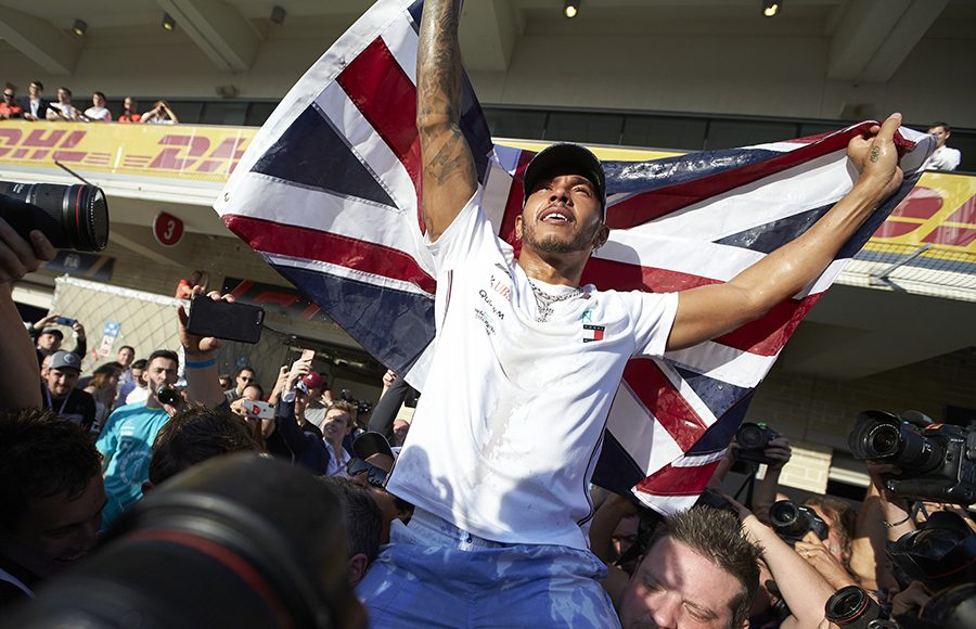 Lewis Hamilton celebrates after claiming his sixth Formula One championship Sunday after the United States Grand Prix. (Steve Etherington Photo)