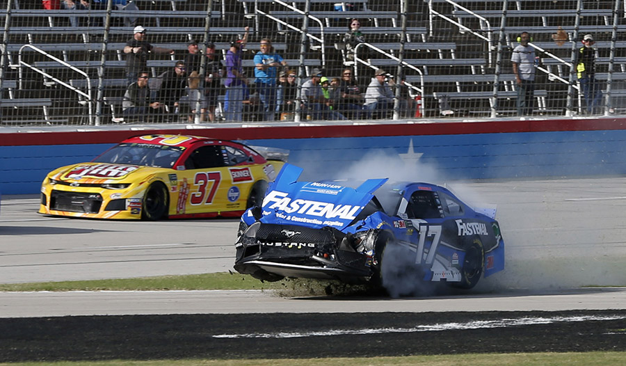 Ricky Stenhouse Jr. plows through the frontstretch grass after a crash early in Sunday's AAA Texas 500 at Texas Motor Speedway. (HHP/Ashley Dickerson Photo)
