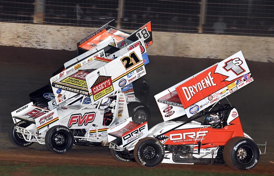 Logan Schuchart (1s), Brian Brown (21) and Ian Madsen race three-wide during the sprint car portion of Friday's Can-Am World Finals event at The Dirt Track at Charlotte. (Frank Smith Photo)