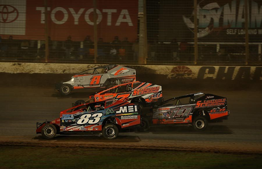 Super DIRTcar Series drivers battle four-wide for position during Friday's Can-Am World Finals event at The Dirt Track at Charlotte. (Dallas Breeze Photo)