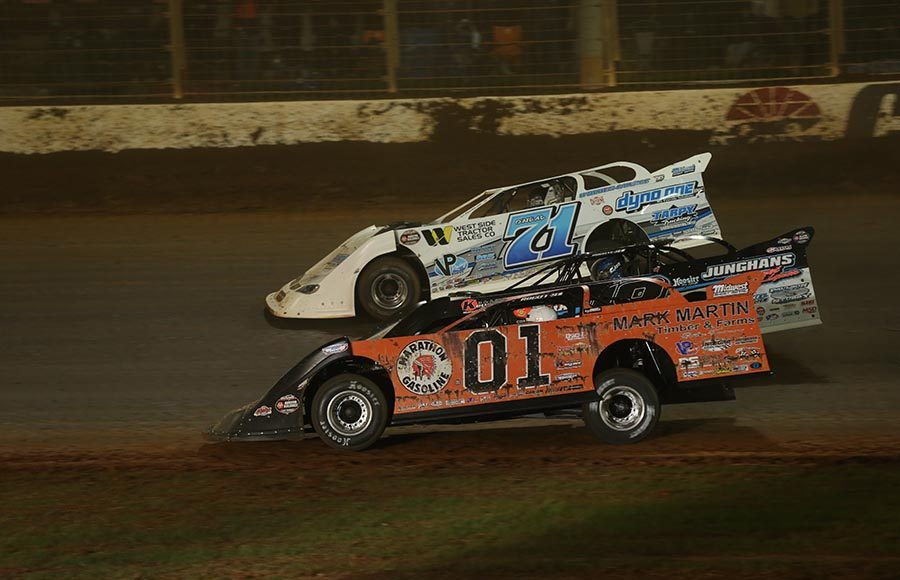 Mike Marlar (01), Chase Junghans (18) and Hudson O'Neal race three-wide during Friday's World of Outlaws Morton Buildings Late Model Series event at The Dirt Track at Charlotte. (Dallas Breeze Photo)