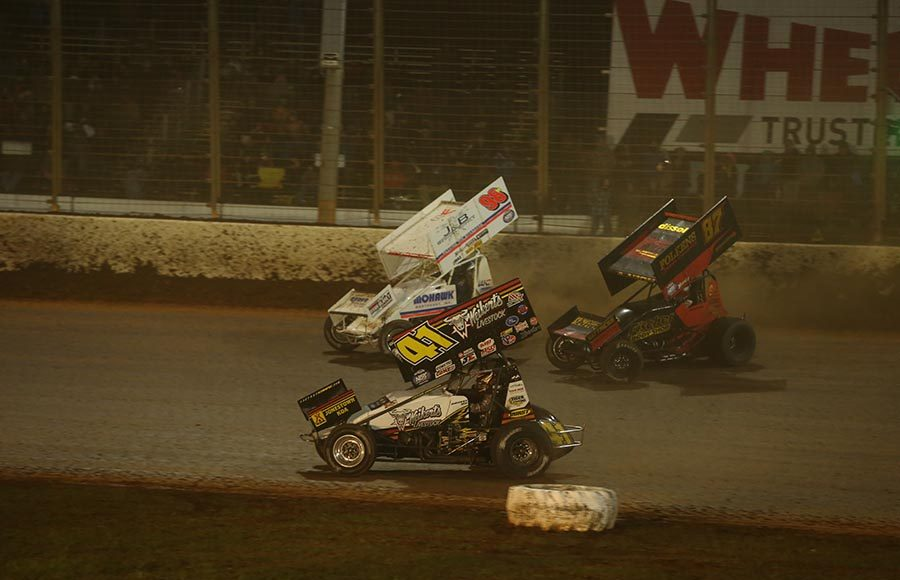David Gravel (41) takes the lead from Aaron Retuzel (87) after Dave Blaney ran in front of Reutzel during Friday's World of Outlaws NOS Energy Drink Sprint Car Series feature at The Dirt Track at Charlotte. (Dallas Breeze Photo)