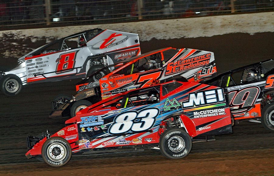 Brian Swartzlander (83), Tim Fuller (19), Michael Maresca (7) and Max McLaughlin battle four-wide during Friday's Super DIRTcar Series feature at The Dirt Track at Charlotte. (Jim Denhamer Photo)