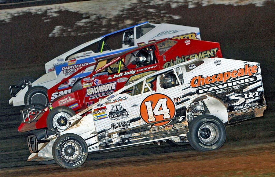 Daniel Johnson (14), Justin Haers (3) and Justin Wright battle three-wide during Friday's Super DIRTcar Series feature at The Dirt Track at Charlotte. (Jim Denhamer Photo)