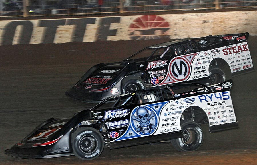 Scott Bloomquist (0) battles teammate Chris Madden during Friday's World of Outlaws Morton Buildings Late Model Series feature at The Dirt Track at Charlotte. (Jim Denhamer Photo)