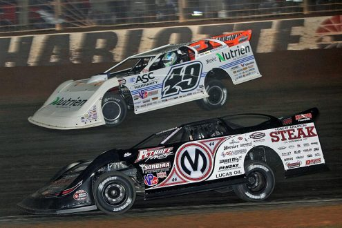 Chris Madden (0M) battles Jonathan Davenport for the race lead during Friday's World of Outlaws Morton Buildings Late Model Series feature at The Dirt Track at Charlotte. (Jim Denhamer Photo)
