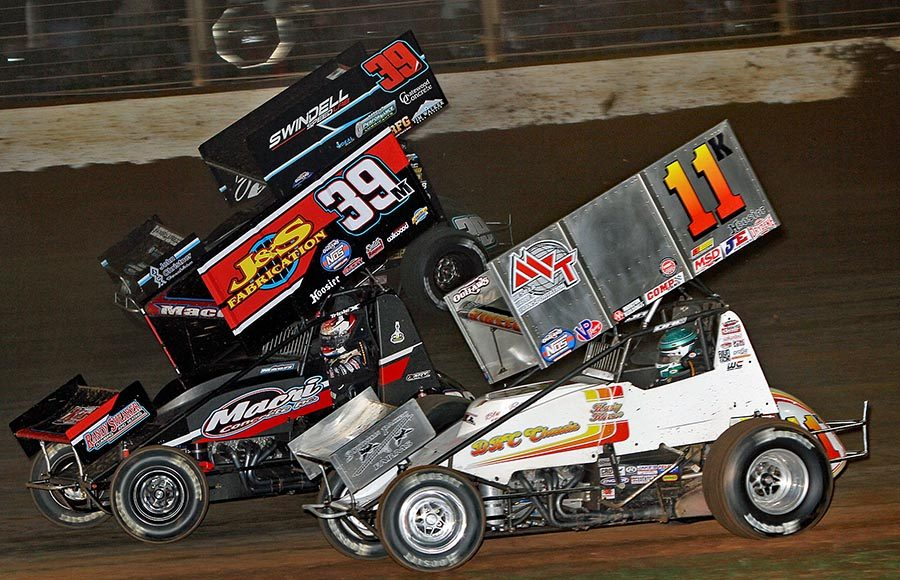 Kraig Kinser (11), Anthony Macri (39) and Spencer Bayston battle for position during Friday's World of Outlaws NOS Energy Drink Sprint Car Series event at The Dirt Track at Charlotte. (Jim Denhamer Photo)