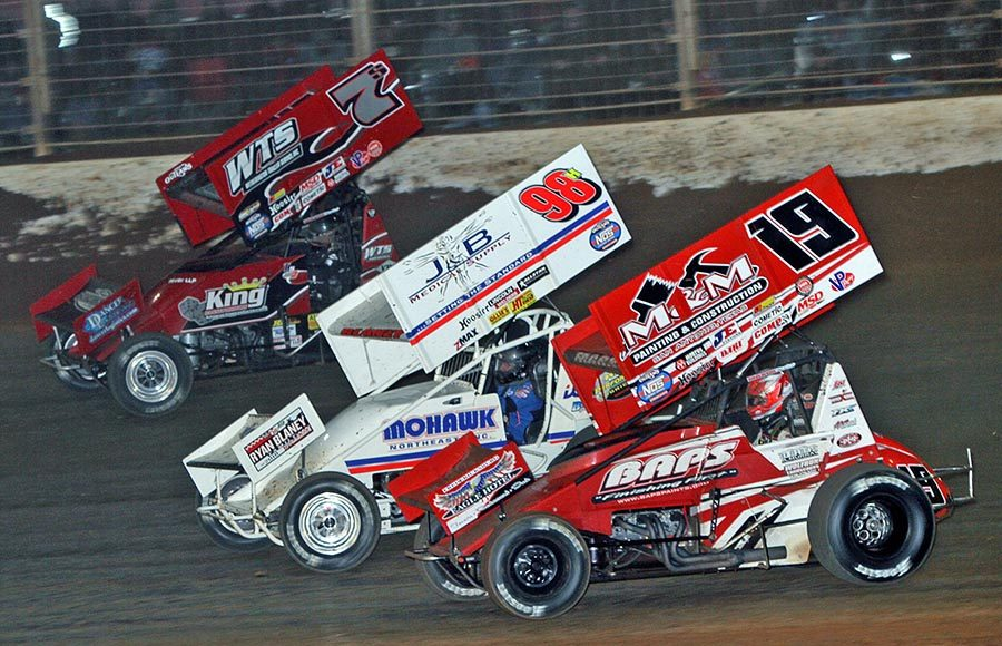 Brent Marks (19), Dave Blaney (98h) and Tim Shaffer race for position during Friday's World of Outlaws NOS Energy Drink Sprint Car Series event at The Dirt Track at Charlotte. (Jim Denhamer Photo)