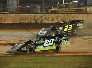 Jimmy Owens (20) races past John Blankenship during Saturday's World of Outlaws Morton Buildings Late Model Series feature at The Dirt Track at Charlotte. (Dallas Breeze Photo)