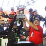 Ty Gibbs hoists the trophy after winning Saturday's NASCAR K&N Pro Series West finale at ISM Raceway. (Ivan Veldhuizen Photo)