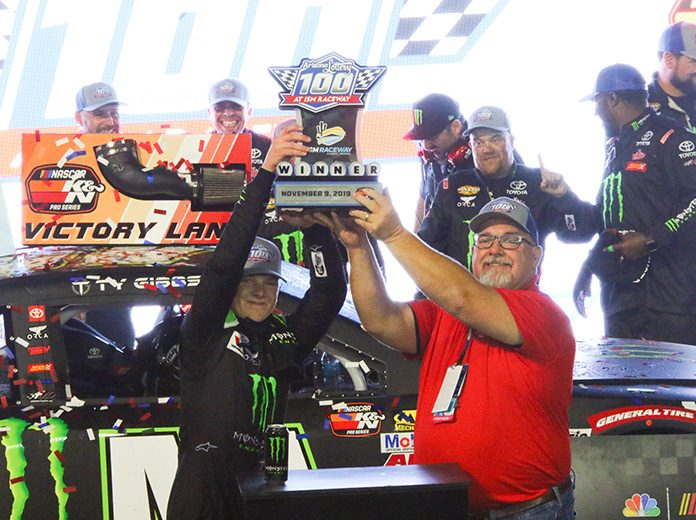 Ty Gibbs hoists the trophy after winning Saturday's NASCAR K&N Pro Series West finale at ISM Raceway. (Ivan Veldhuizen Photo)