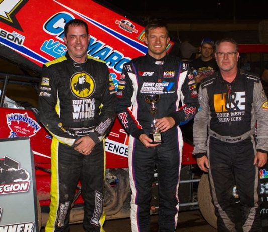 John Carney (center) is joined on the podium by Mark Dobmeier and Eric Wilkins. (Ron Gilson photo)