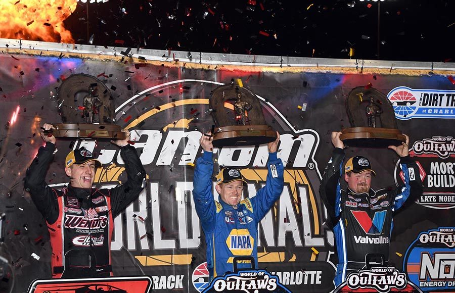 (From left) Mat Williamson, Brad Sweet and Brandon Sheppard celebrate after clinching their respective championships Saturday at The Dirt Track at Charlotte. (Frank Smith Photo)