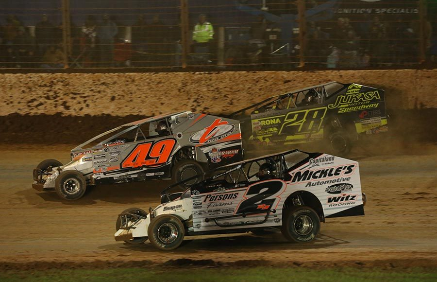 Ronnie Johnson (2RJ), Billy Dunn (49) and Gary Lindberg battle for position during the Super DIRTcar Series feature at The Dirt Track at Charlotte. (Dallas Breeze Photo)