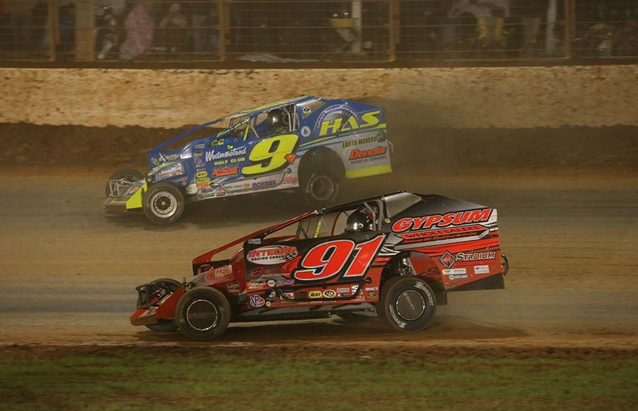 Billy Decker (91) races alongside Matt Sheppard during Saturday's Super DIRTcar Series finale at The Dirt Track at Charlotte. (Dallas Breeze Photo)
