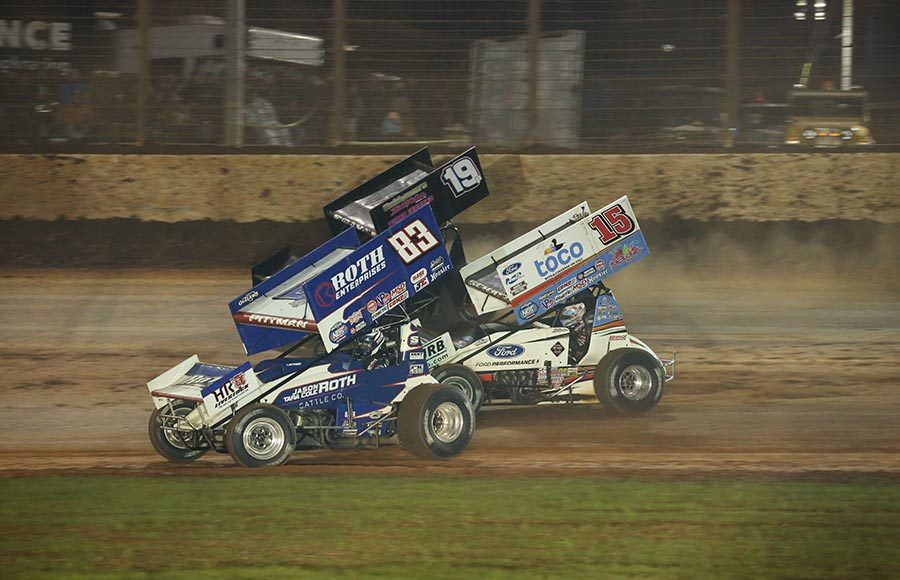 Daryn Pittman (83), Donny Schatz (15) and Paige Polyak race for position during Saturday's World of Outlaws NOS Energy Drink Sprint Car Series finale at The Dirt Track at Charlotte. (Dallas Breeze Photo)