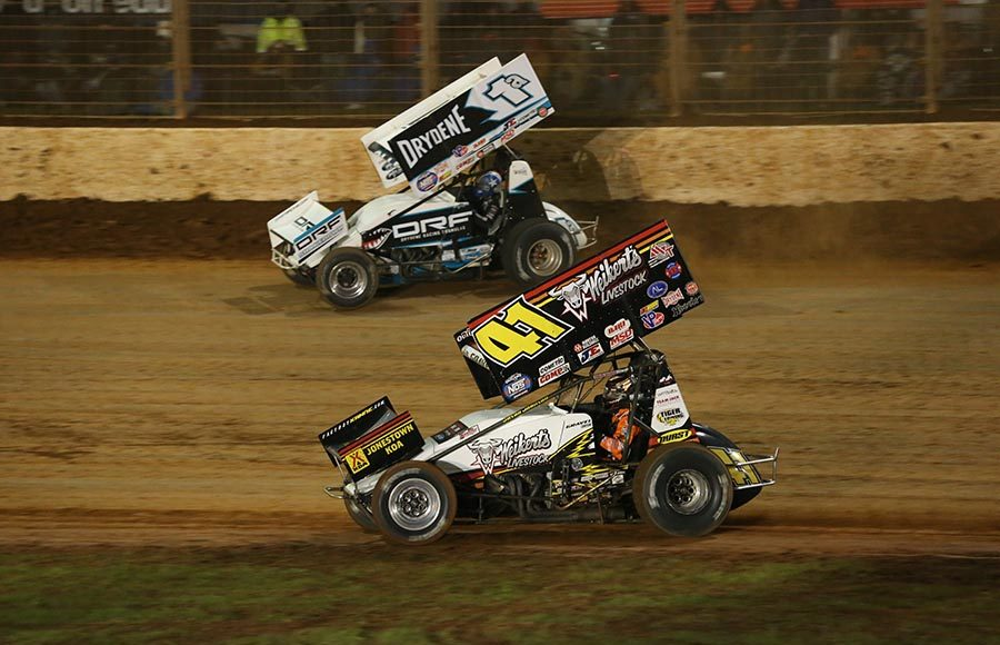 Jacob Allen (1a) battles David Gravel during Saturday's World of Outlaws NOS Energy Drink Sprint Car Series finale at The Dirt Track at Charlotte. (Dallas Breeze Photo)