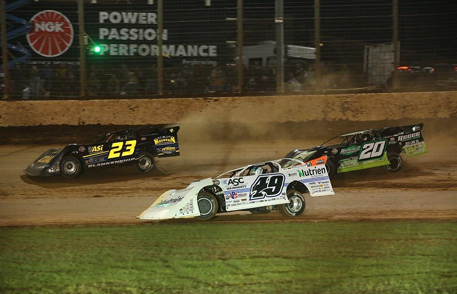 John Blankenship (23), Jonathan Davenport (49) and Jimmy Owens race for the lead during Saturday's World of Outlaws Morton Buildings Late Model Series finale at The Dirt Track at Charlotte. (Dallas Breeze Photo)
