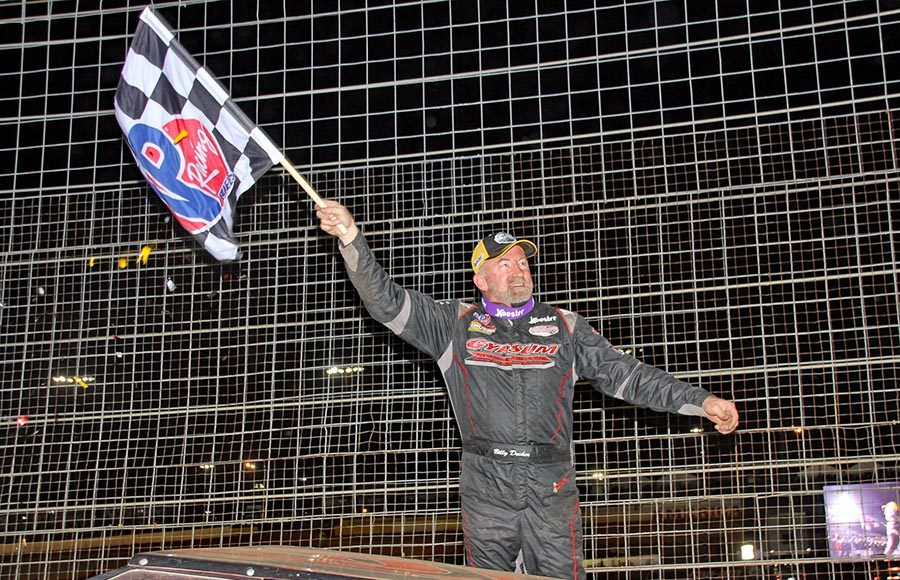 Billy Decker celebrates after winning Saturday's Super DIRTcar Series finale at The Dirt Track at Charlotte. (Jim Denhamer Photo)