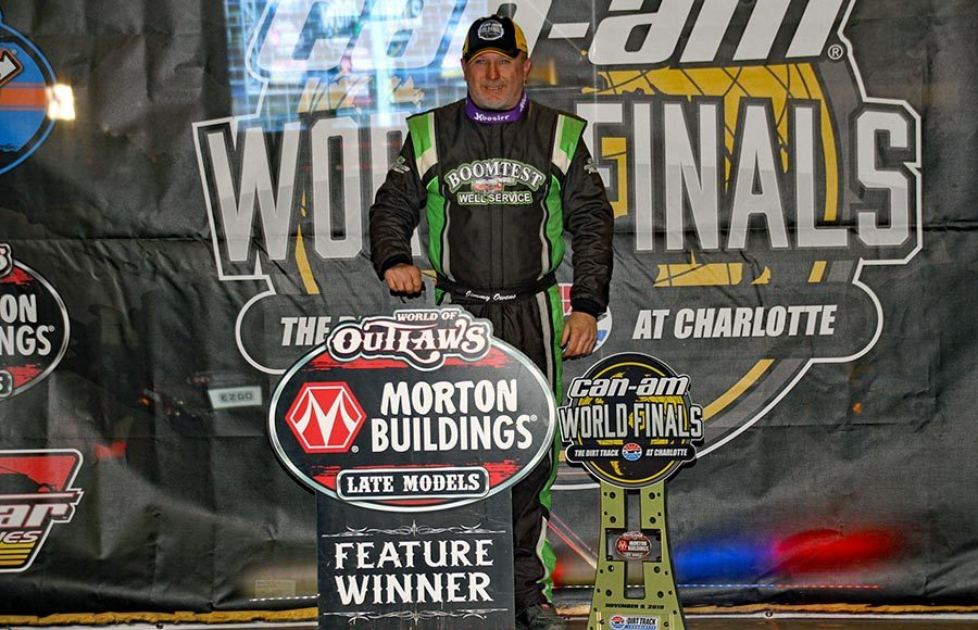 Jimmy Owens poses in victory lane after winning the World of Outlaws Morton Buildings Late Model Series finale at The Dirt Track at Charlotte Saturday. (Jim Denhamer Photo)
