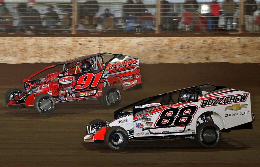 Mat Williamson (88) races Billy Decker during Saturday's Super DIRTcar Series feature at The Dirt Track at Charlotte. (Jim Denhamer Photo)