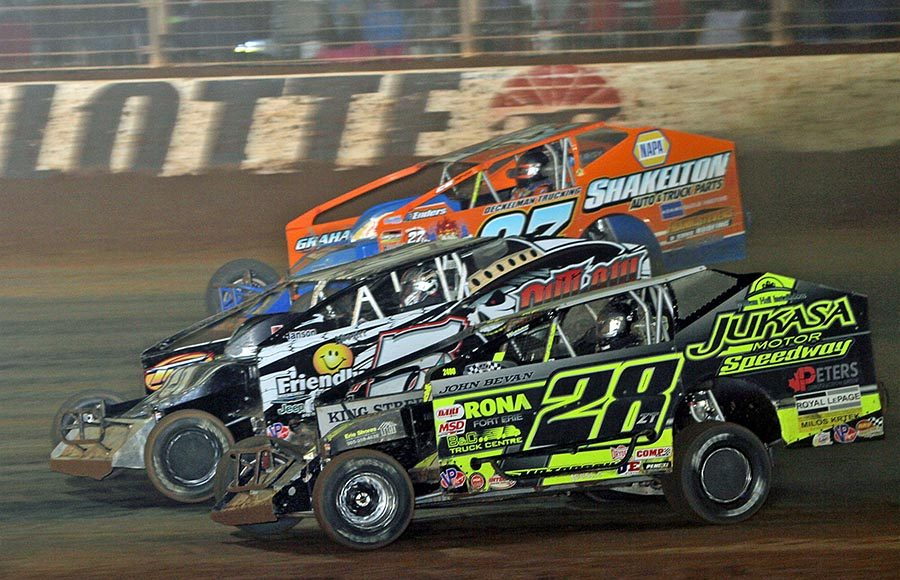 Gary Lindberg (28), Tyler Siri (5) and Danny Johnson race for position during Saturday's Super DIRTcar Series event at The Dirt Track at Charlotte. (Jim Denhamer Photo)