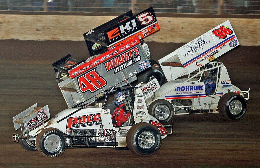 Danny Dietrich (48), Dave Blaney (98h) and Shane Stewart race three-wide during Saturday's World of Outlaws NOS Energy Drink Sprint Car Series event at The Dirt Track at Charlotte. (Jim Denhamer Photo)