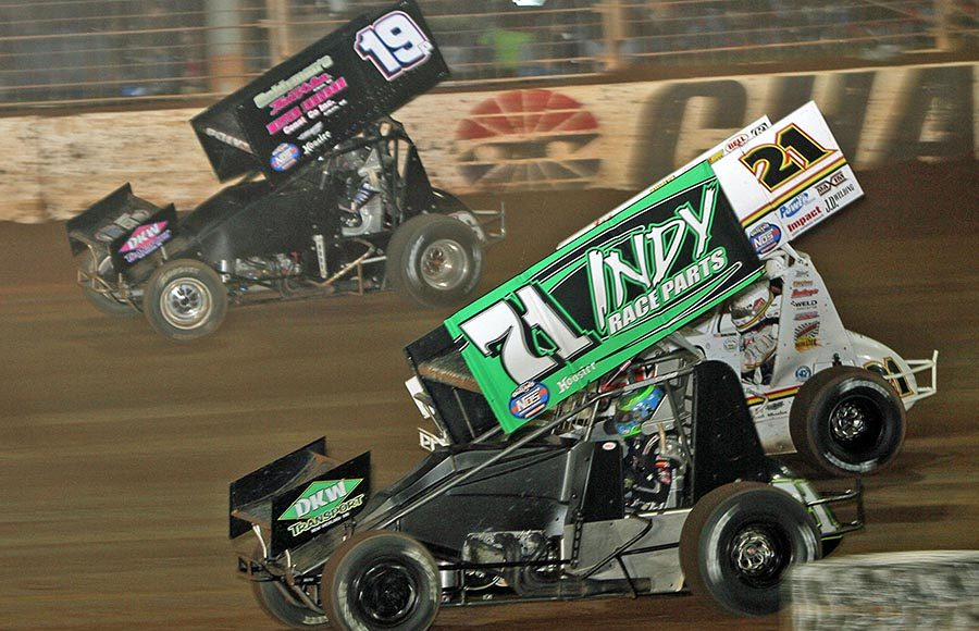 Gio Scelzi (71), Brian Brown (21) and Paige Polyak battle for position during Saturday's World of Outlaws NOS Energy Drink Sprint Car Series event at The Dirt Track at Charlotte. (Jim Denhamer Photo)
