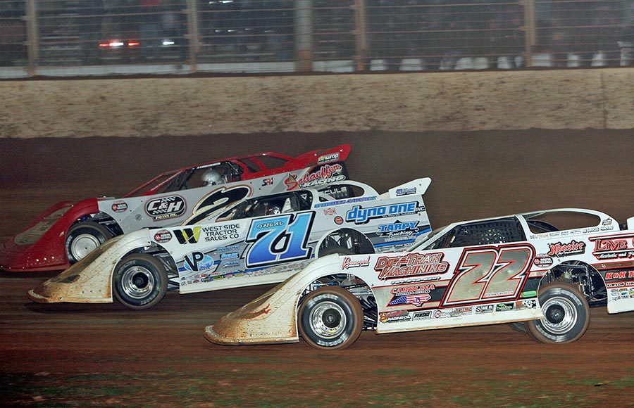 Chris Ferguson (22), Hudson O'Neal (71) and Brandon Overton battle for position during Saturday's World of Outlaws Morton Buildings Late Model Series finale at The Dirt Track at Charlotte. (Jim Denhamer Photo)
