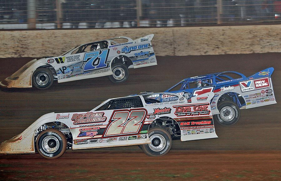 Chris Ferguson (22), Brandon Sheppard (1) and Hudson O'Neal battle three-wide during Saturday's World of Outlaws Morton Buildings Late Model Series finale at The Dirt Track at Charlotte. (Jim Denhamer Photo)